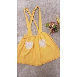 Falda con tirantes de bambula con bolsos de crochet